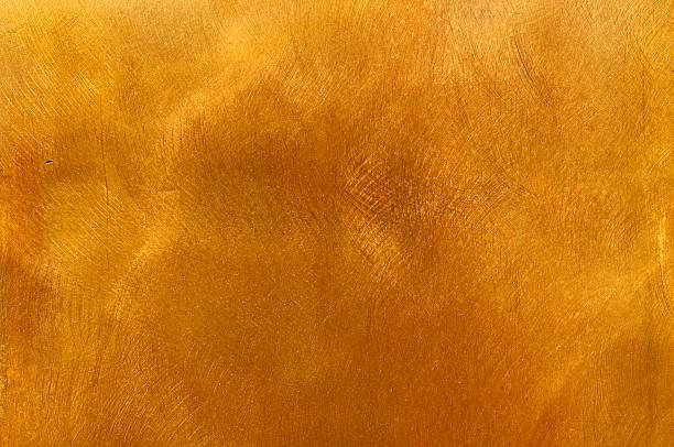 Abstract golden brass plate mottled texture for backgrounds stock photo