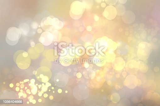 Abstract golden festive bokeh background with glitter sparkle blurred circles and Christmas lights. Concept Christmas, Happy New Year and other holidays.