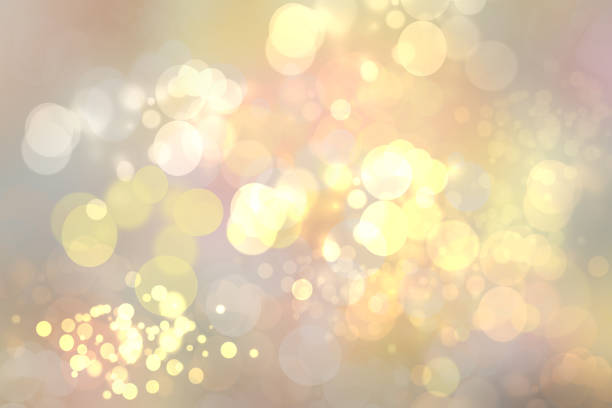 abstract golden festive bokeh background with glitter sparkle blurred circles and christmas lights. concept christmas, happy new year and other holidays. - rozjarzony zdjęcia i obrazy z banku zdjęć