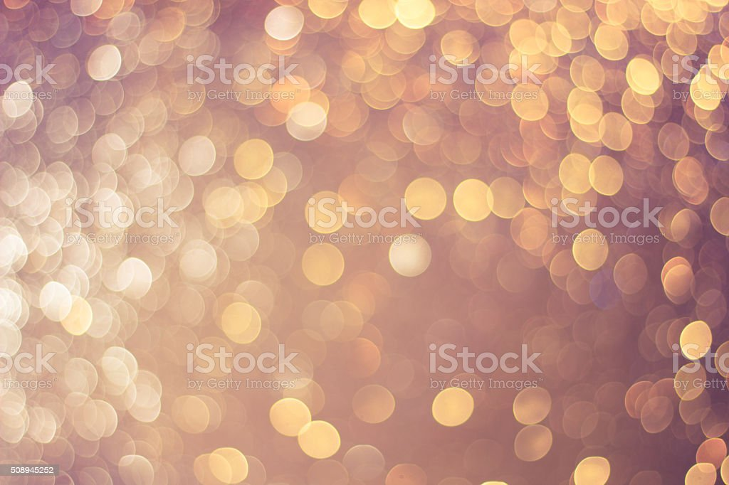 Abstract golden light bokeh light background in vintage tone. stock photo