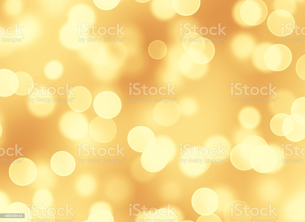 Abstract golden lights bokeh background stock photo