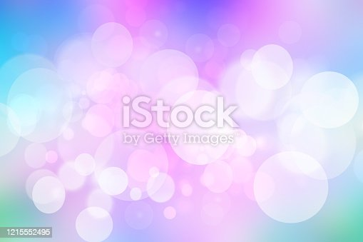 524700656 istock photo Abstract gradient of light blue pink pastel background texture with glowing circular bokeh lights. Beautiful colorful spring or summer backdrop. 1215552495
