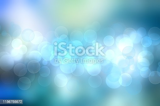524700656 istock photo Abstract gradient of light blue turquoise pastel background texture with glowing circular bokeh lights. Beautiful colorful spring or summer backdrop. 1156755572