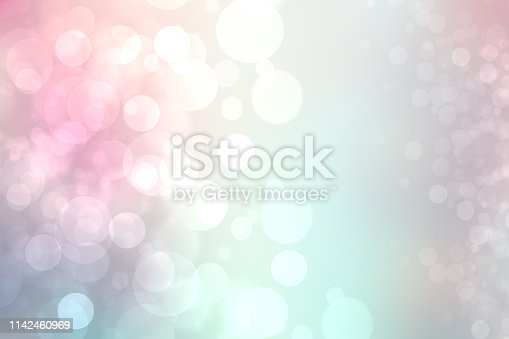 524700656 istock photo Abstract gradient of pink blue pastel light background texture with glowing circular bokeh lights. Beautiful colorful spring or summer backdrop. 1142460969