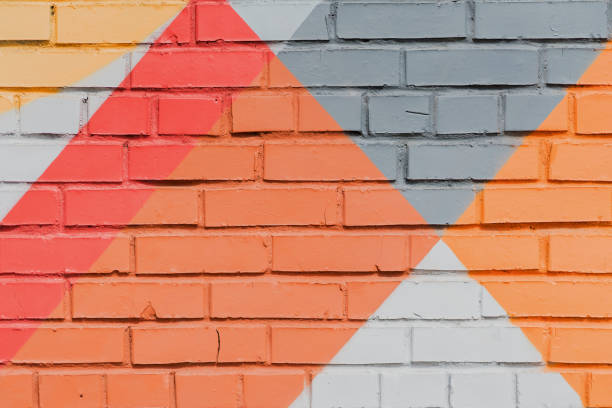 Abstract graffiti on the wall, very small detail. Street art close-up, stylish pattern. Can be useful for backgrounds and backdrops. Aerosol pictures stock photo