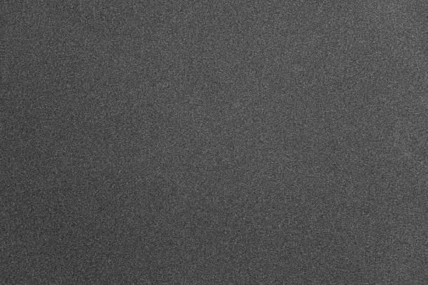 abstract gray grainy paper texture background - asfalto foto e immagini stock