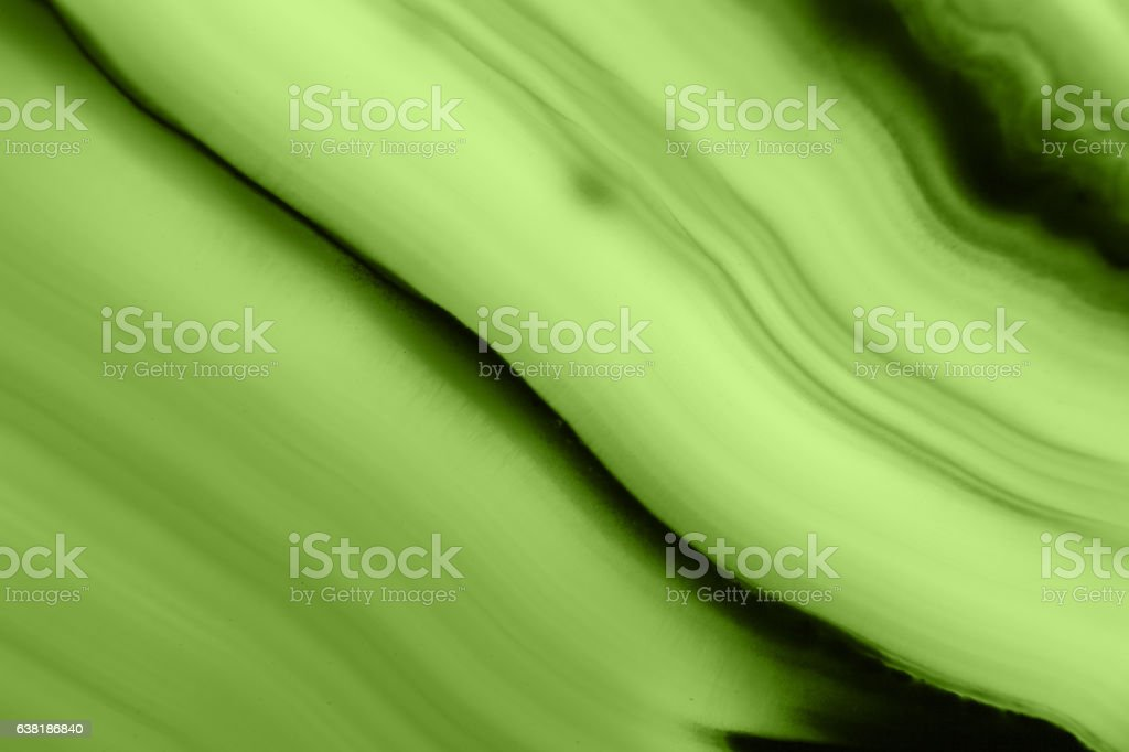 Abstract green agate slice mineral macro (PANTONE 15-0343 greenery) stock photo