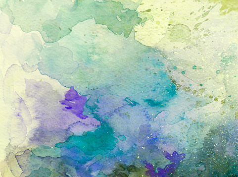 Colorful watercolor background transparent with layers and splashes on white watercolor paper. My own work.