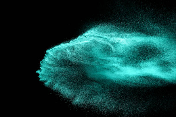 abstract  green colored sand splash on black background. color dust explode on background  by throwing freeze stop motion. - stop motion stock photos and pictures