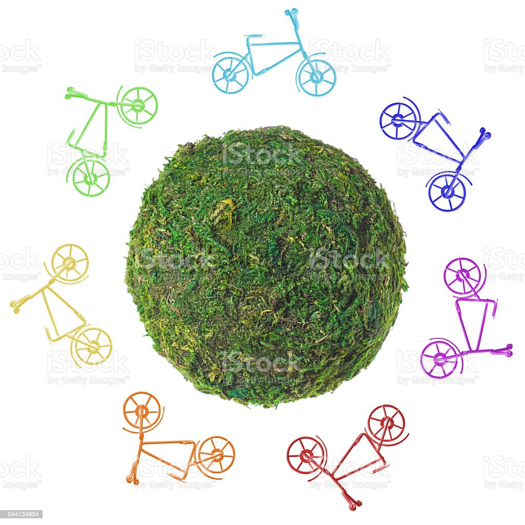 Abstract green planet with bicycles on a white background стоковое фото
