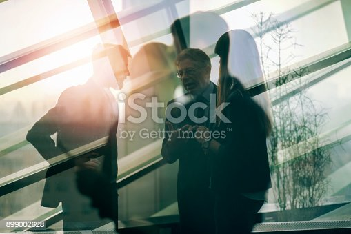istock Abstract group of business people in the office 899002628