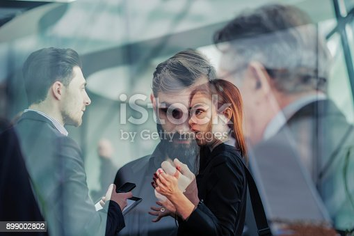 istock Abstract group of business people in the office 899002802
