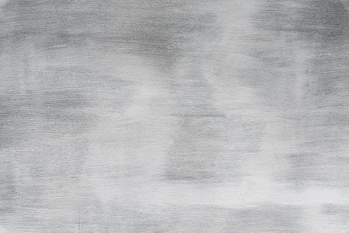 Abstract grunge background. Texture of plaster wall with brush traces, gray color