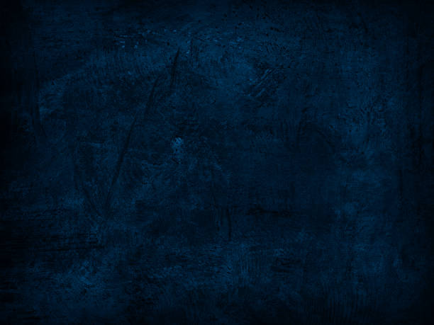 Abstract grunge dark blue background Close up on scratched metal surface, with blue color conversion made in Photoshop. dark blue stock pictures, royalty-free photos & images