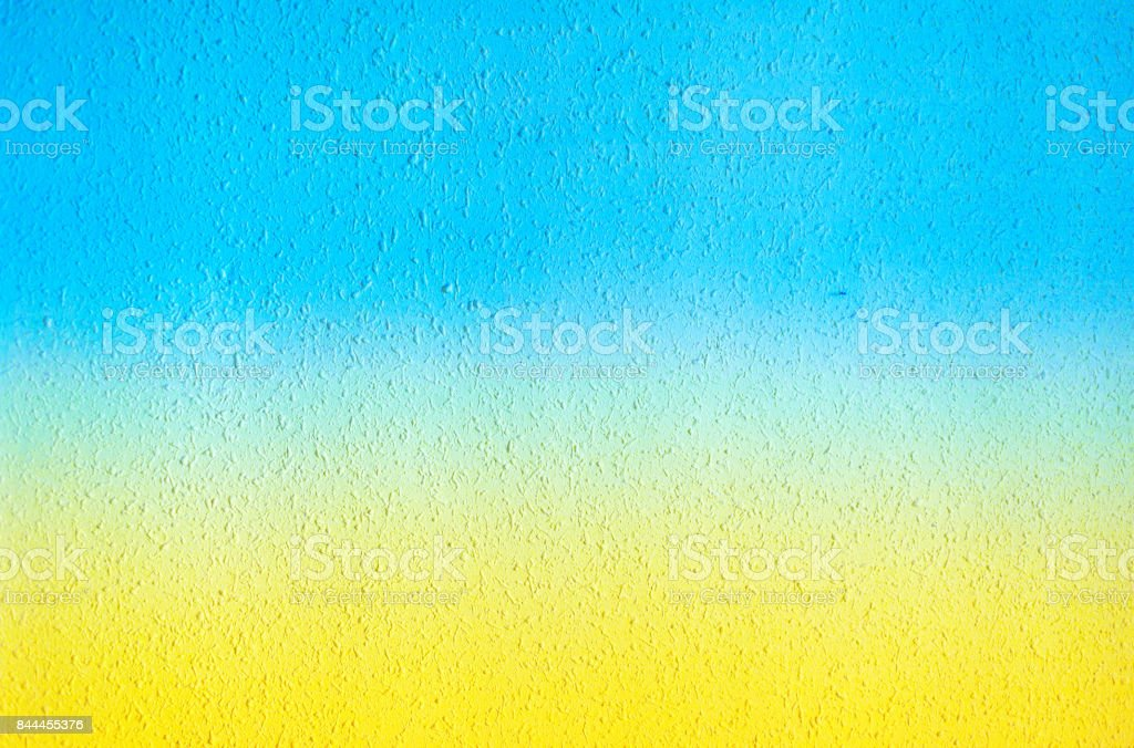 Abstract grunge summer concept  textured background with grain and scratches. Summer gradient wall in yellow and blue colors'n stock photo
