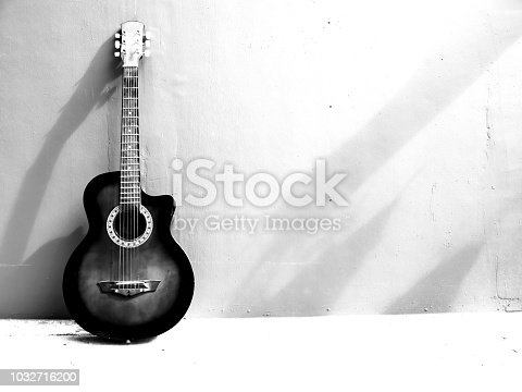 istock Abstract guitar on black and white color shape. 1032716200