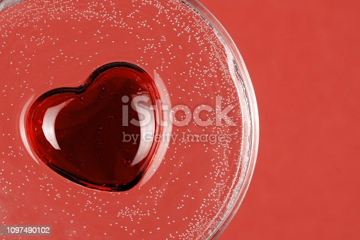908708148 istock photo Abstract heart as a symbol of Valentine day with air bubble in water. Living coral color - 2019 1097490102