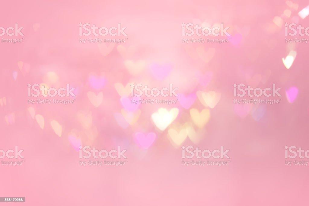 Coração abstrato bokeh em fundo rosa - foto de acervo