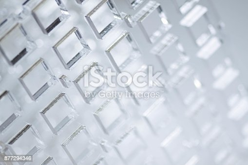 istock Abstract high-tech background. A sheet of transparent plastic or glass with the cut out holes. Laser cutting of plexiglass 877294346