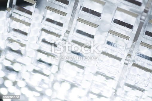 istock Abstract high-tech background. A sheet of transparent plastic or glass with the cut out holes. Laser cutting of plexiglass 878255578