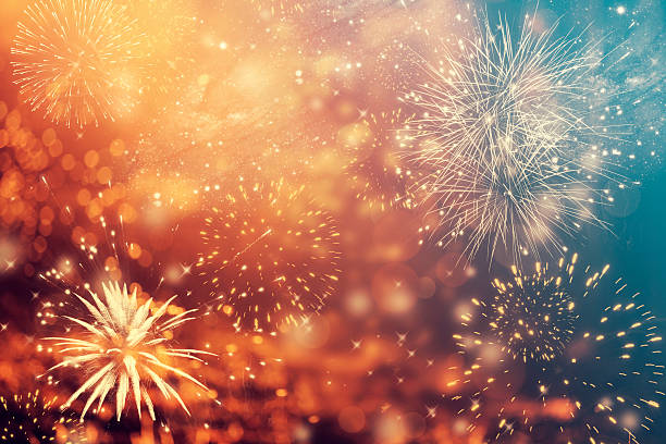 abstract holiday background with fireworks - anniversary stock photos and pictures
