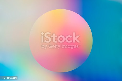istock Abstract holographic background with circle 1013807280