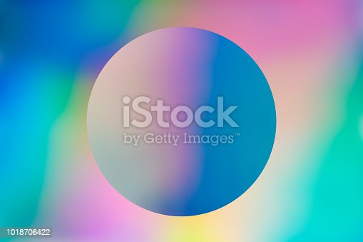 istock Abstract holographic background with circle 1018706422