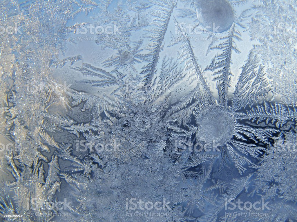 Abstract ice natural pattern on winter window glass stock photo