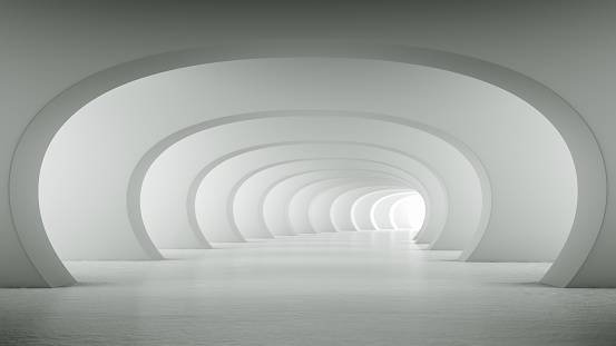 istock Abstract illuminated empty white bent corridor with round arches 1179948377