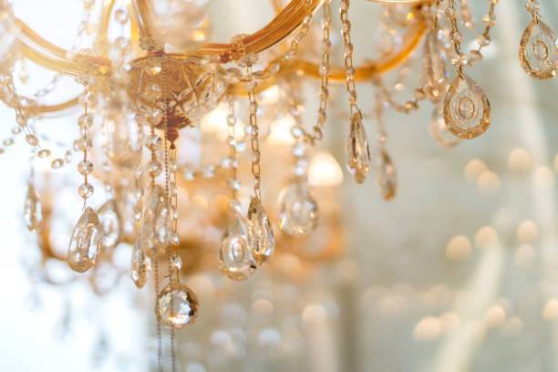 abstract image background of blur bokeh and crystal chandelier light equipment filter tone color effect abstract image background of blur bokeh and crystal chandelier light equipment filter tone color effect chandelier stock pictures, royalty-free photos & images