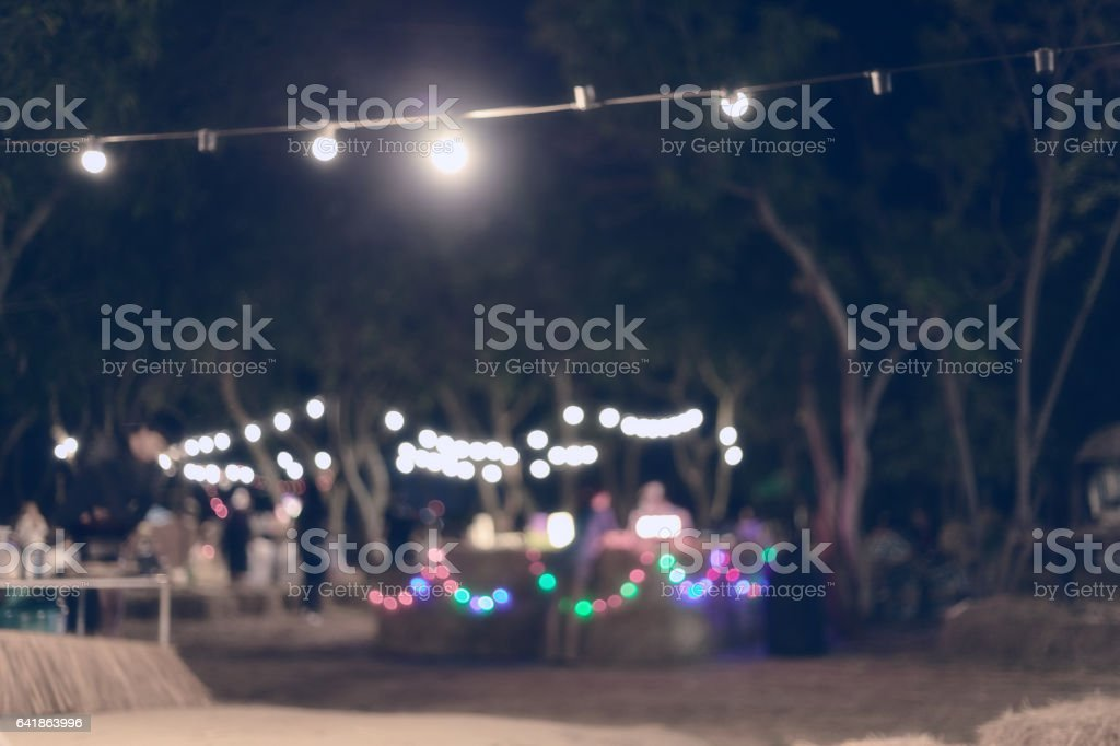 abstract image blurred defocused background and decoration light christmas celebration hanging on tree stock photo