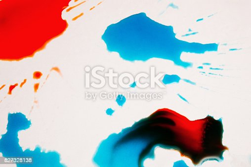 istock Abstract image of colorful splashes on white 827328138