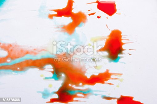 istock Abstract image of colorful splashes on white 828378066