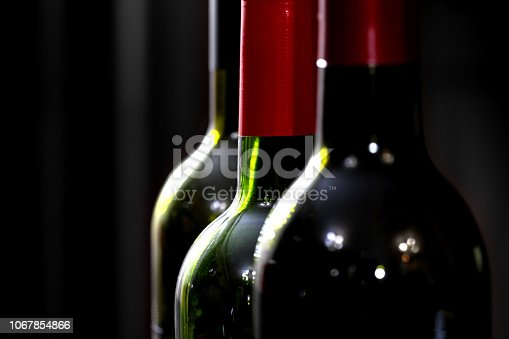 872334598 istock photo Abstract image of glass bottles 1067854866