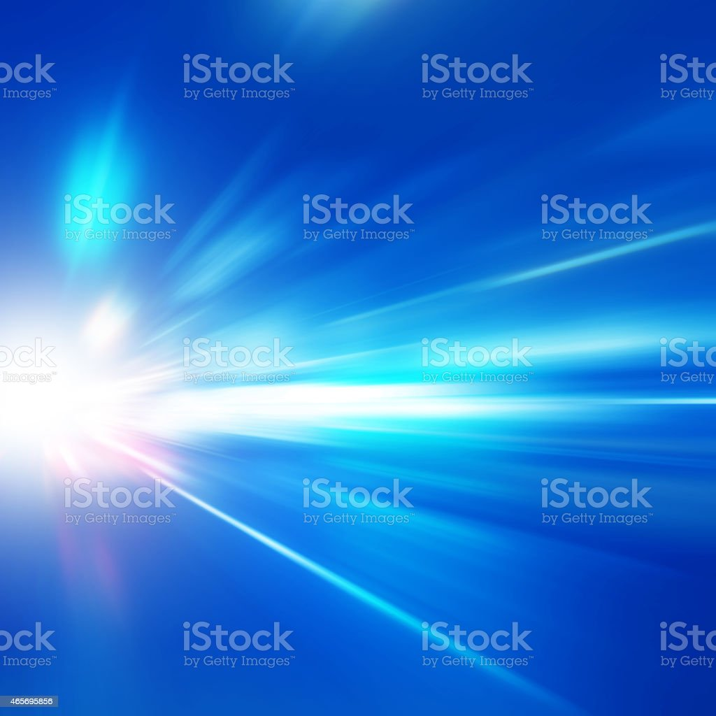 Abstract image of light in motion on blue background stock photo