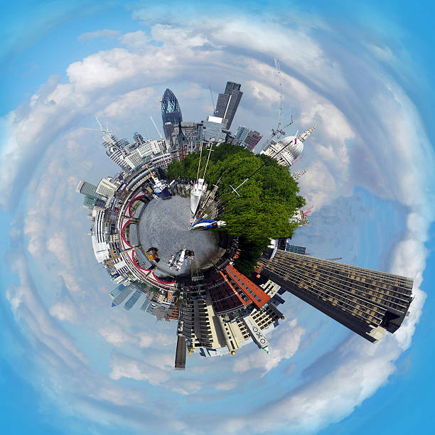 Abstract image of London as a planet Tiny Planet Panorama of London Skyline from the Embankment. fish eye lens stock pictures, royalty-free photos & images