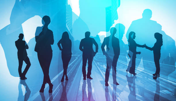 abstract image of many business people together in group on background of city - double exposure стоковые фото и изображения