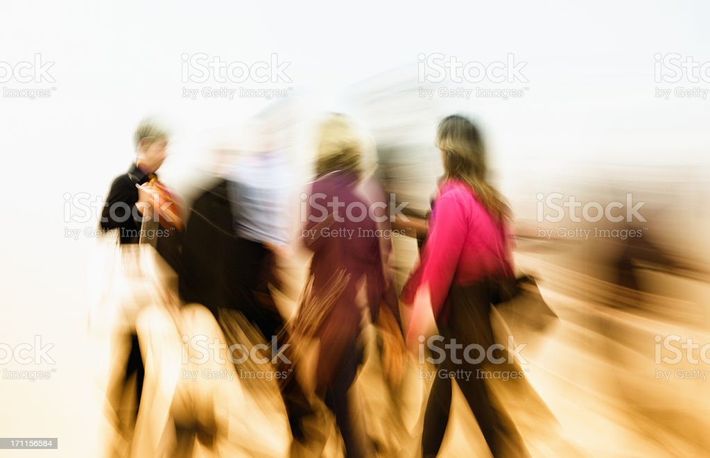 Abstract Image of Motion Blurred Colorful Dressed People  Walking Fast royalty-free stock photo