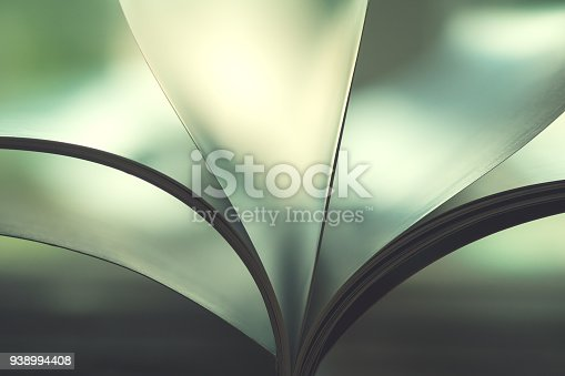 istock Abstract image of pages of a open book 938994408