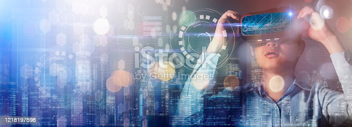 875503222 istock photo abstract image of the asian scientist doctor using a VR glasses and overlay with futuristic graphic hologram technology ideas concept 1218197598