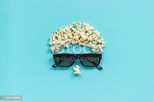 istock Abstract image of viewer, 3D glasses and popcorn on blue background. Concept cinema movie and entertainment Flat lay Top view 1130406853
