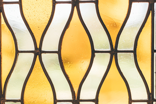 Abstract image of yellow-white stained glass window