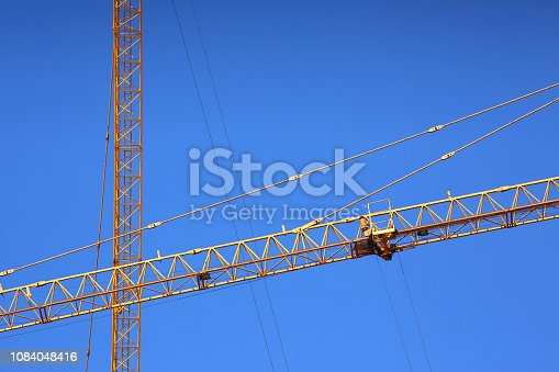 istock abstract image, part of arm machinery construction crane with blue sky background 1084048416