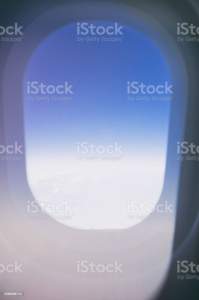 Abstract In-flight Air Travel Image of Airplane Porthole royalty-free stock photo