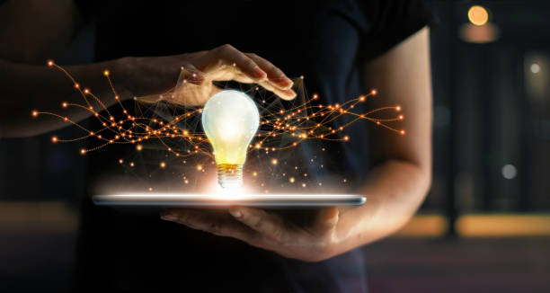 Abstract. Innovation. Hands holding tablet with light bulb future technologies and network connection on virtual interface background, innovative technology in science and communication concept. Abstract. Innovation. Hands holding tablet with light bulb future technologies and network connection on virtual interface background, innovative technology in science and communication concept. arbiter stock pictures, royalty-free photos & images