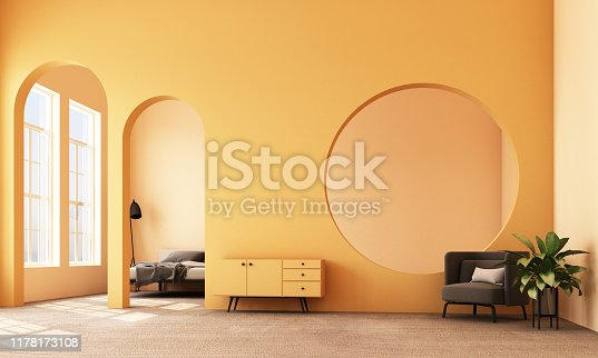istock Abstract interior design.living area and bedroom with architectural elements in yellow tone, circular arc, round opening and concrete floor.3d rendering 1178173108