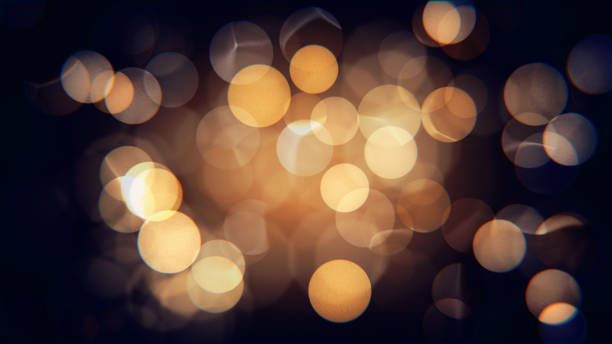 보 케와 추상 고립 된 흐리게 축제 노란색과 오렌지 크리스마스 조명 - 빗나간 포커스 뉴스 사진 이미지