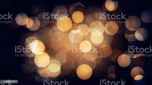 Photo of Abstract isolated blurred festive yellow and orange Christmas lights with bokeh