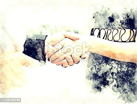 istock Abstract Join hands business concept and handshake concept on watercolor painting background. 1129150296