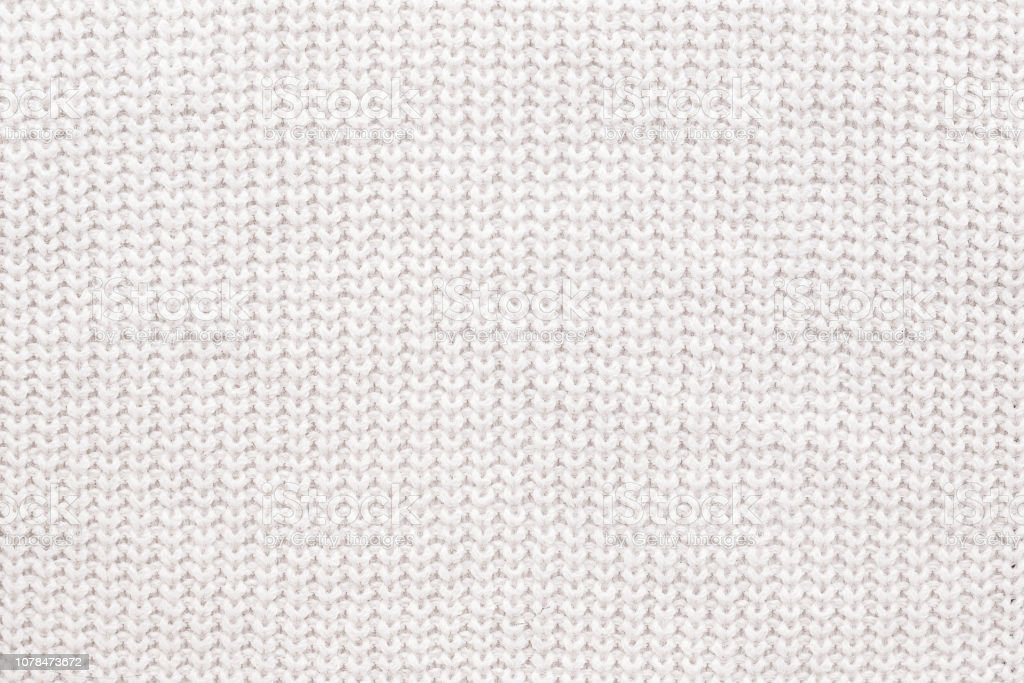 Abstract knitted background. White woolen sweater texture. Close up picture of  knitted pattern. stock photo